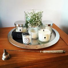 Gather all of your candles in one place. | 17 Free Ways To Make Your Grown-Up Apartment So Freaking Cozy