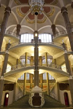 One of the two identical symmetrical main staircases within the main hall of the Amtsgericht Berlin ~ by Jarrod Hayes