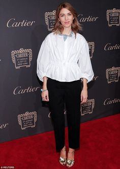 The trusty black-and-white combination: Sofia Coppola donned a boxy white tunic with black slacks