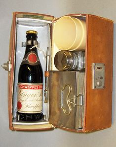 tx for sharing Bonhams London,  Important Collectors' Motor Cars and Fine Automobilia 2006 : A leather cased small travelling sandwich set by Coracle, 1930s. domed top two person set with food box, bottle and Beatl beakers, the lid fitted with Schweppes Ginder Ale bottle and bottle opener, the case 26cm wide. Food Box, Recipe Box, Motor Car, Leather Case, Wine Rack, Coca Cola, 1930s, Bottle Opener, Ale