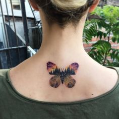 Double exposure butterfly tattoo on the upper back. Tattoo artist: Eva krbdk