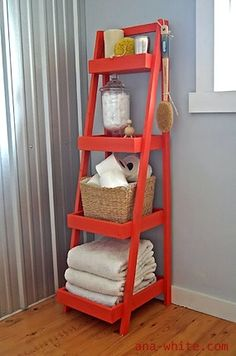 storage for towels on freestanding shelf unit