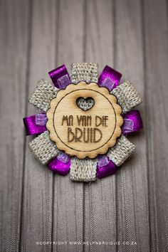 A beautiful rosette badge with a wooden template and a option of 3 different ribbons