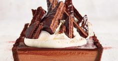 """""""This is that perfect combination of simple and spectacular. Tim Tams make a decadent chocolate crust and decorative 'spires', while two types of ganache create a rich, smooth filling. Make it ahead for a dinner party, then just dollop with cream and top with Tim Tams. Believe me, your guests will s"""
