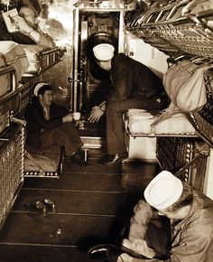 80-G-41788: Life onboard USS Cuttlefish (SS 171). Crew quarters are compact, but comfortable. Here during off duty hours, seaman read, shine shoes, or just sit and talk. Photographed June 8, 1943. U.S. Navy Photograph, now in the collections of the National Archives. (2016/05/10).