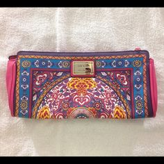 """Nicole Miller multi-color Indian-style print purse Multi-colored, Indian-style print. Rectangular shape. Textured synthetic leather. Has 2 compartments. Can be carried as a clutch or cross-body - detachable strap included (strap is adjustable). Brand new w/o tags.  Measurements as follows: approx. 11 ¾"""" across, approx. 5 7/8"""" tall, approx. 1 ¾"""" deep but somewhat expandable, approx. 14 ¼"""" strap drop (at shortest adjustment), approx. 27 ¾"""" strap drop (at longest adjustment). *Note: Strap will…"""