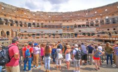Tourists visit the Roman vestiges inside the Colosseum, major touristic attraction in Rome, Italy-4