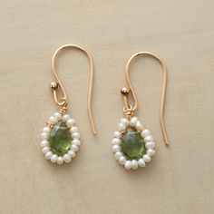 Green Pavilion Earrings Faceted apatite teardrops are framed in freshwater cultured seed pearls, on 14kt goldfilled French earwires. USA. Exclusive.
