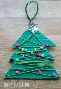 Yarn and Bead Christmas Tree Craft - The Imagination Tree xmas tree ideas craft Christmas Trees For Kids, Preschool Christmas, Noel Christmas, Christmas Crafts For Kids, Christmas Activities, Christmas Wrapping, Xmas Tree, Christmas Projects, Holiday Crafts