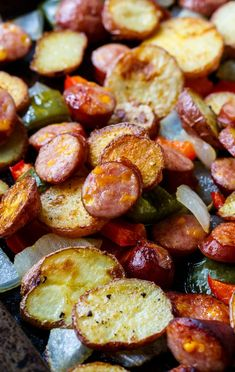 Oven-Roasted Sausage and Potatoes with onions and peppers - Spicy Southern Kitchen Slices of potato and sausage plus green and red pepper, and onion are roasted until golden for an easy, one pan meal. Sausage Potatoes And Peppers, Sausage And Potato Bake, Baked Red Potatoes, Potatoes In Oven, Oven Roasted Potatoes, Oven Baked Sausage, Sausage Meals, Slow Cooking, Cooking Recipes