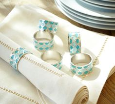 Turquoise napkin rings with a shimmery wave-inspired motif