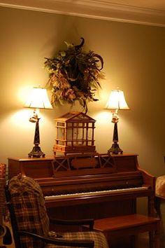 piano  decor, minus the feathery wreath