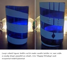 Large cobalt blue liquor bottle cut to create vase or candle holder, with white painted candy stripe over 'Happy Holidays' and ornament embellishment. Thick glass, so this is very heavy.Top cut is smoothed but still slightly organic.