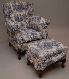 70: Small wing back chair and ottoman with blue toile f : Lot 70