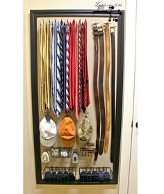 Get your husband's accessories clean and organized with this wall decor for his ties, belts, and hats!