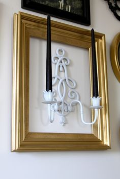 I don't like the gold frame, but I like the idea of framing a candle holder