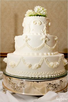 Traditional white cake with hydrangea topper - Photo by Jeremy