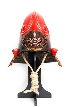 'Red fantastic helmet (kawari kabuto 変わり兜) with demonic shishi,' 17th century, iron, cord, laquer, leather by International Arts & Artists
