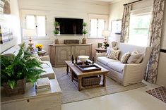 love the sofa    and the tv and topiaries styling    kristin alber's mesa home feature on the lettered cottage blog