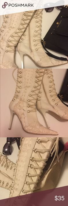 "Faux crock lace up heels Cream color side zip boots. Lacing in the front and back. 4"" heel. Light wear. No tag to indicate material but might be synthetic. Wow heels! Shiekh Shoes Lace Up Boots"