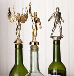 Wine corks from old trophies-brilliant! (also shows you how to us trophies as a coat hook & cake stand)