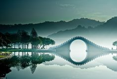 This remarkable, soft blue, monochrome picture of The Moon Bridge, in DaHu (Big Lake) Park in Taipei, northern Taiwan, were taken by an arguably talented photographer, known simply as bbe022001 on Flickr. I'd love to have this one on a wall to see regularly!