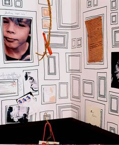 Paint an entire wall full with frames fit for regular paper sizes for the kids to show of their artwork!