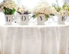 Small budget? Monogrammed cups can be used as a vase for centerpiece, then you can use at home too! Great combo!