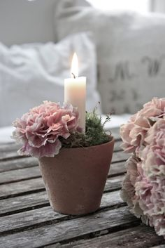Flowers arranged as candle holders... cute idea for rehearsal... NOT CARNATIONS @deanna hughes Loden