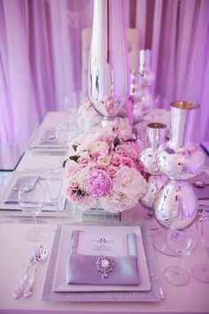 WEDDING STYLE #1 GLAMOUROUS // You love the thought of chandeliers, rich and regal tones of purple, silver, gold and all that shimmers and glitters.  You are not afraid of opulence and you are drawn to pretty details and eye catching special touches.  For the glamourous bride,  ballroom reception spaces with draping and candelabras, lush and lavish floral arrangements and sleek and stylish wedding party style will help create the look.