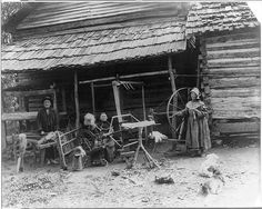 Mary Faust standing next to large walking wheel, an umbrella swift, another woman seated at a spinning wheel with a distaff and a skein winder in front of her, and a man processing flax on a flax break with a counterbalance loom behind him. Appalachian People, Appalachian Mountains, Appalachian Recipes, Catskill Mountains, Old Pictures, Old Photos, Vintage Photographs, Vintage Photos, Antique Photos