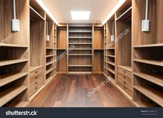 stock-photo-wide-wooden-dressing-room-interior-of-a-modern-house-182860121.jpg 1 500×1 095 пикс