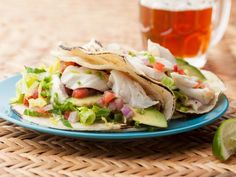 Fish Tacos : Aida Mollenkamp's fish tacos are authentically deep fried, flaked and served with avocado, salsa and sour cream. via Food Network Fish Recipes, Seafood Recipes, Mexican Food Recipes, Dinner Recipes, Ethnic Recipes, Mexican Dishes, Recipies, Mexican Cooking, Top Recipes