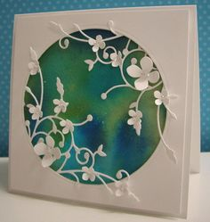 Background paper made with water and re-inkers mixed in an Aqua Painter and used on watercolor paper. Circle is diecut. Foliage is diecut. By Loll Thompson
