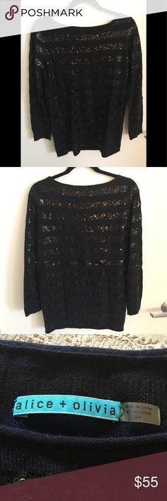 Alice + Olivia Wool and Sequin Sweater *Price Drop!* Look no further for your next statement piece! This Alice + Olivia navy wool and black sequin tunic sweater is guaranteed to turn heads, whether you dress it down with some light wash skinnies or wear with black trousers for an elevated casual look. Worn once, in pristine condition. 100% wool. True to size, though meant to be slightly oversized.   Will consider all serious offers! Alice + Olivia Sweaters Crew & Scoop Necks