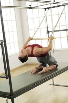 A staple of every well-equipped Pilates facility, the Cadillac offers an extensive range of applications for everyone Pilates Reformer Exercises, Pilates Barre, Pilates Studio, Pilates Workout, Cadillac, Push Up Handles, Get Toned, Workout Session, No Equipment Workout