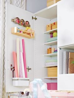 Subtle inside design within the cupboards makes it straightforward to maintain issues organized: in containers and on a magnetic strip on the within of the door, wrapping paper and ribbons have a spot.