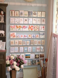 Acrylic strips on a painted wall  can make a lovely display when cards have the same themes (graphics, colors).