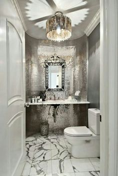 Glamour bathroom... please and thank you. mirrored tile wall, pendant lamp, mirror. amazing!