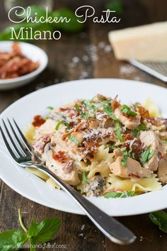 Make the Macaroni Grill classic Chicken Pasta Milano at home- chicken, mushrooms, sun dried tomatoes, Parmesan cheese, basil, and a creamy sauce.