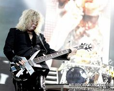 Def Leppard's Rick Savage on June 26, 2011 in Camden, NJ