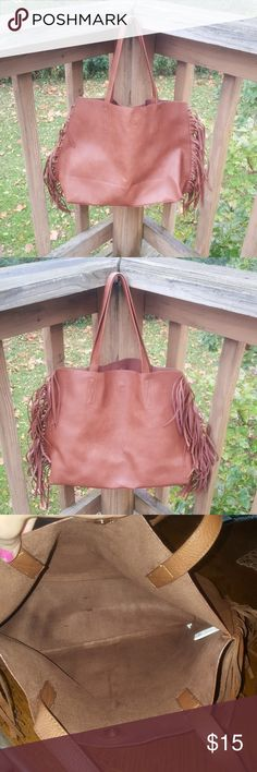 Super cute (vegan) Fringe tote Hello all! This is a super cute fringe tote bag. Great look for fall!  Baught and carried by me personally, from Marshells a few years ago. Only carried a handful of times. Nice big roomy tote with a boho/country vibe. No odors or rips or tears, inside is clean too! Super cute bag! Offers amd questions welcome! :) BP Bags Totes