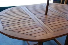 Solid teak table made for outdoors.