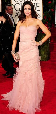 Look of the Day › January 19, 2010 WHAT SHE WORE Blunt complemented her rosy complexion in a ruffled pink tulle custom Dolce & Gabbana design worn with a pair of floral cuffs and a pewter Ferragamo clutch WHERE The 2010 Golden Globes