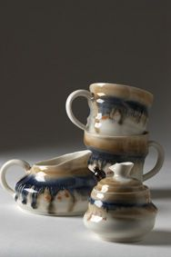 Handmade mug, dripping glazes blue and ochre Made by Laura De Benedetti