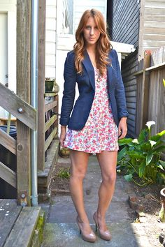 Balance out girly print with solid blue blazer