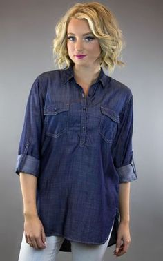 The dark chambray button up top by Sneak Peek is oversized, lightweight, soft and shiny!