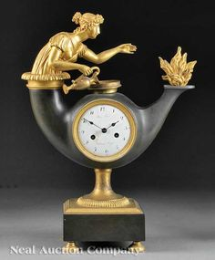 French Restauration Gilt and Patinated  Bronze Mantel Clock, c. 1825