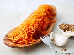 Shredded carrot salad. The carrots in this recipe are marinated in spices, oil and vinegar. Extremely delicious!