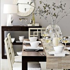 I don't like many dining rooms, but I happen to really like this one.  Black table, simple decor, bold yet quiet room, and totally my style.